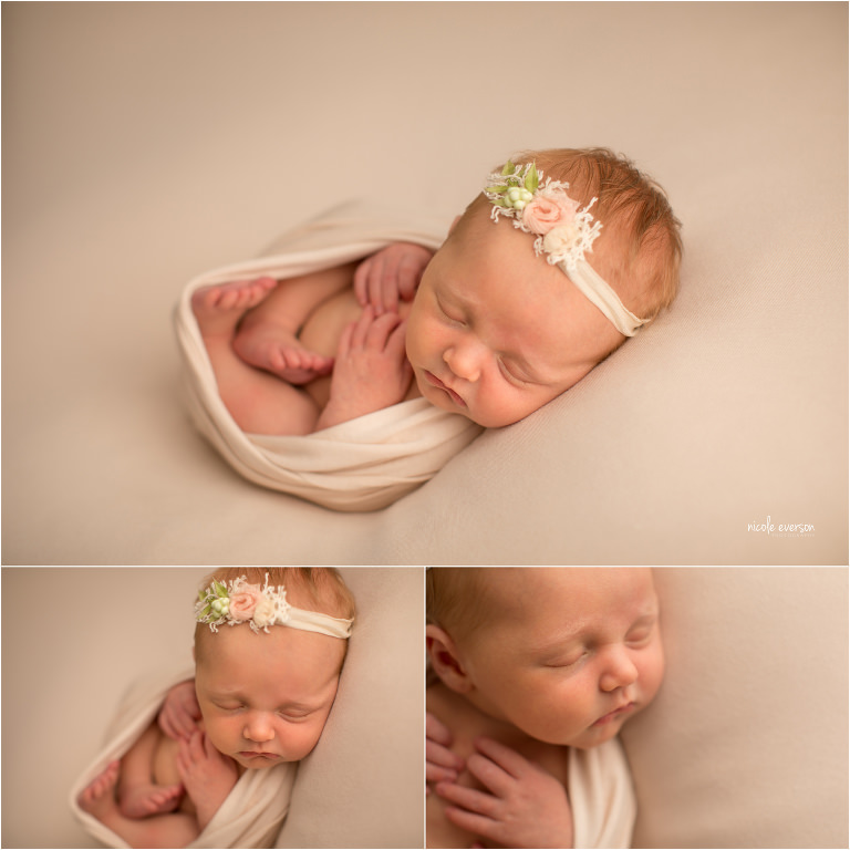picture of a infant baby girl wrapped in a cream blanket