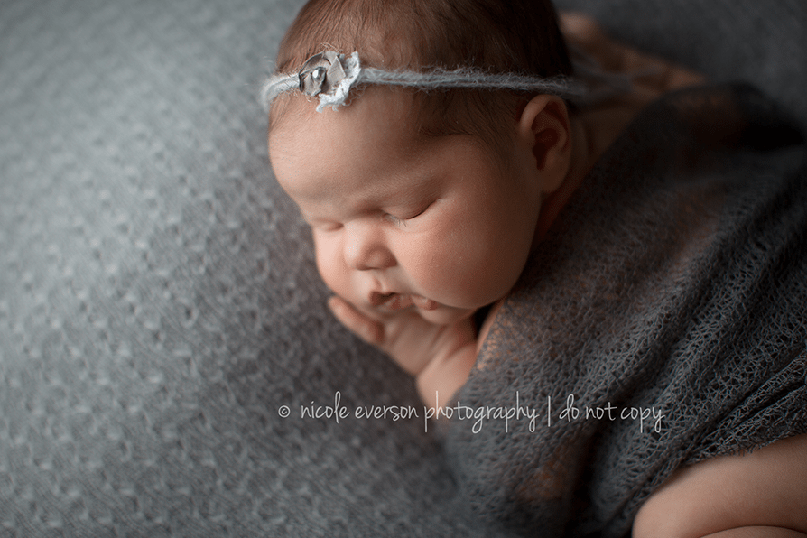 Rustic newborn photography with gray accessories by Nicole Everson