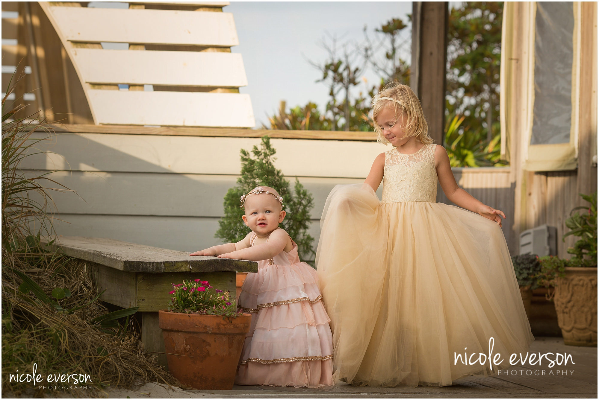 sisters photographed dancing in a well dressed wolf on 30a