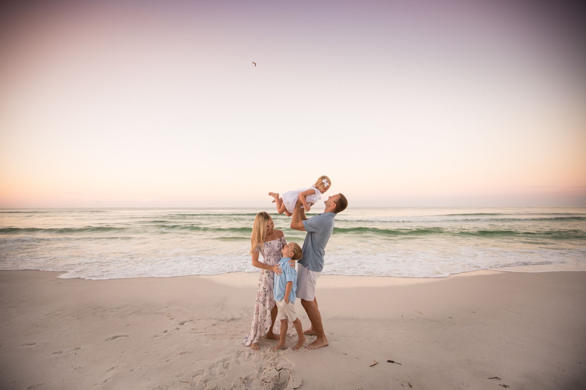 Family photographed on Destin beach on sunrise