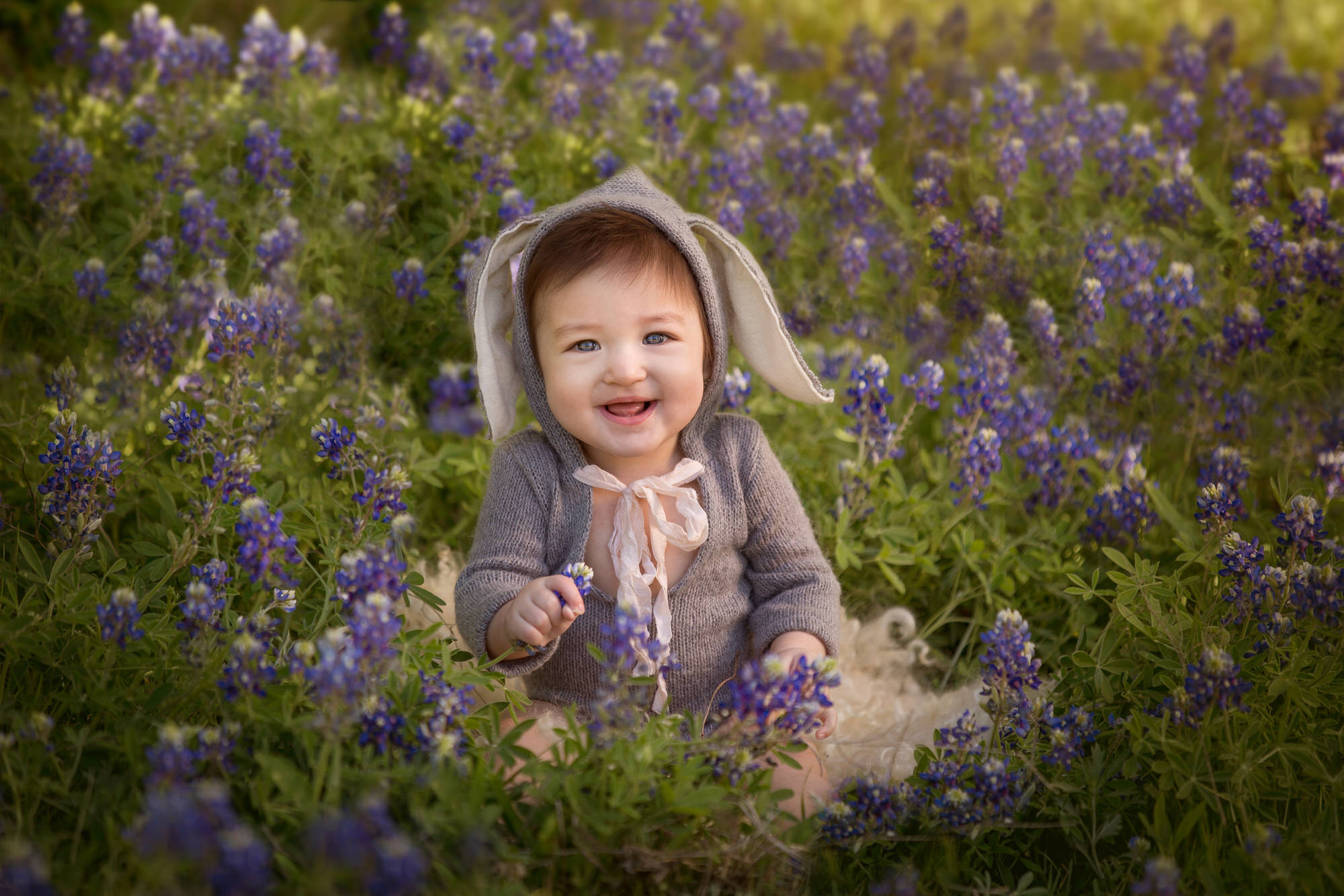 baby boy in a flower patch in Destin fl