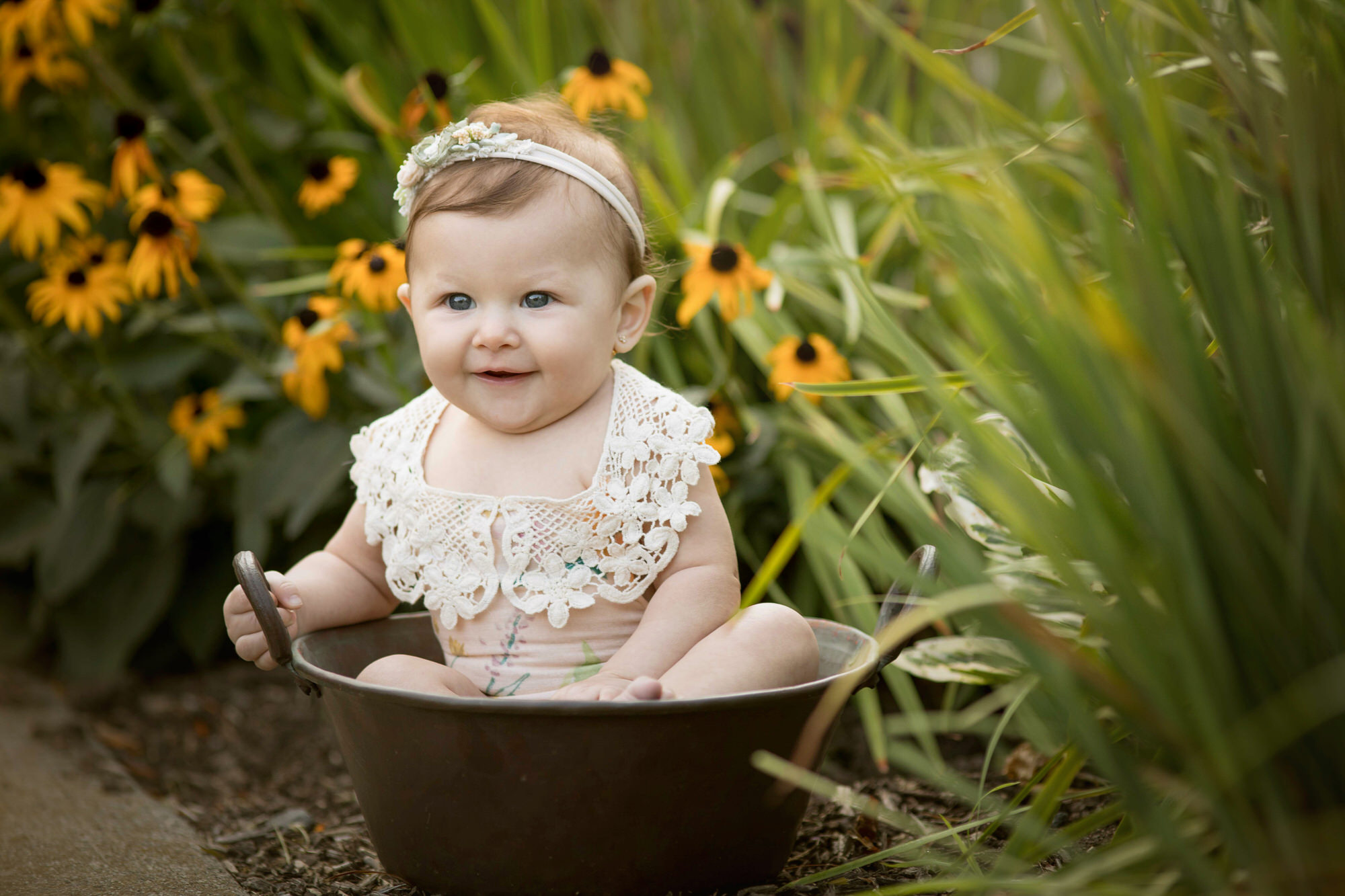 portrait photographed by Nicole Everson Photography of a baby girl in a flower patch