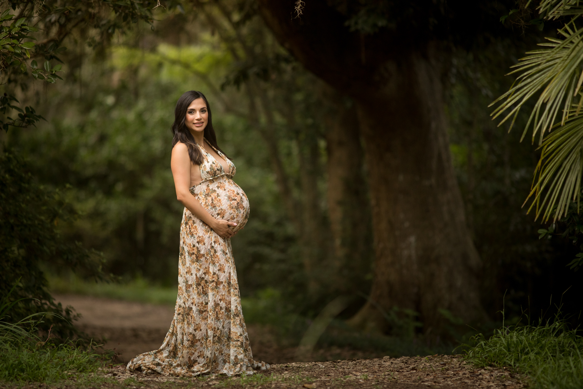 photo of a pregnant woman in a yellow lace maternity gown