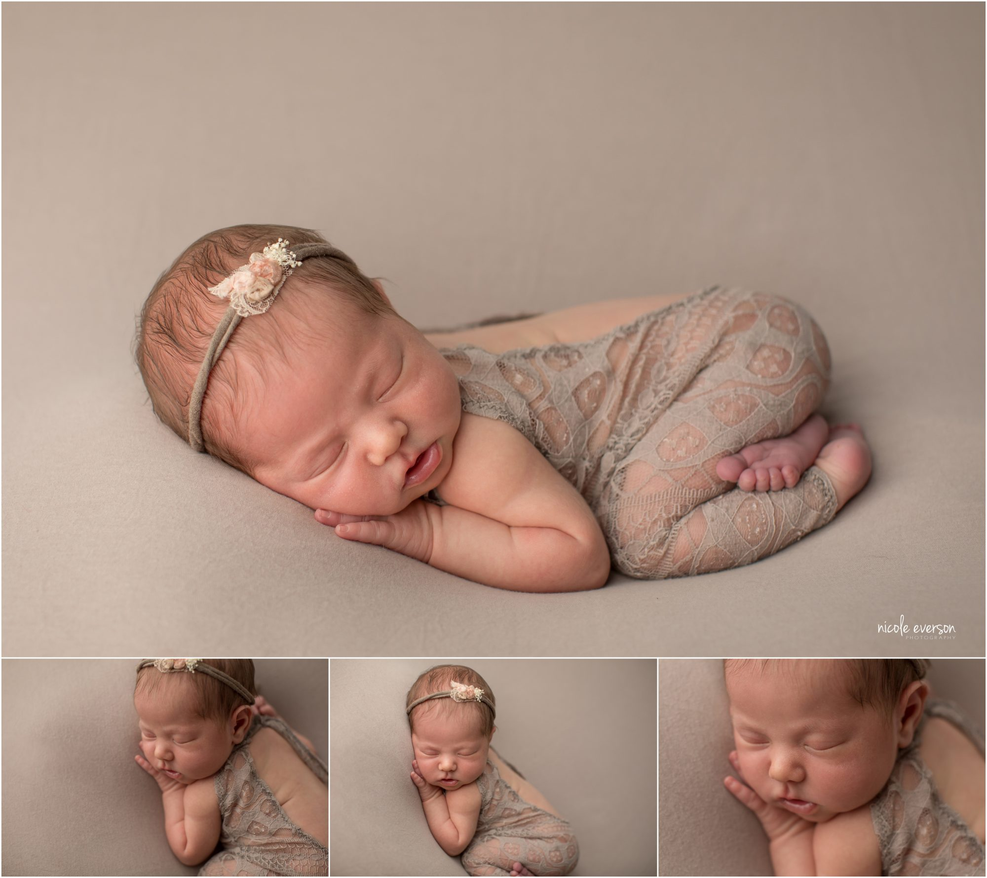 newborn picture of a baby girl smiling on a tan backdrop wearing a tan newborn outfit